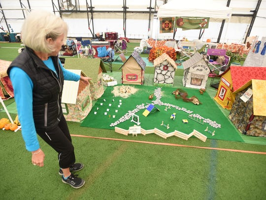Joan Krantz shows off some of the dog villages created