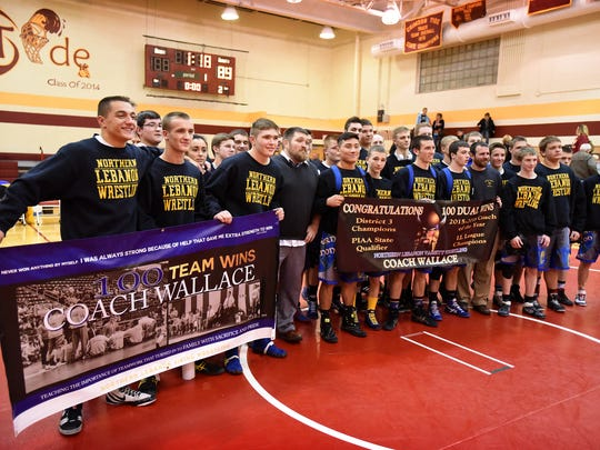 Northern Lebanon wrestling coach Rusty Wallace recorded his 100th career win Wednesday evening, Dec. 14, when the Vikings defeated Columbia 83-0. Vikings wrestlers and coaches pose for pictures following the win at Columbia.