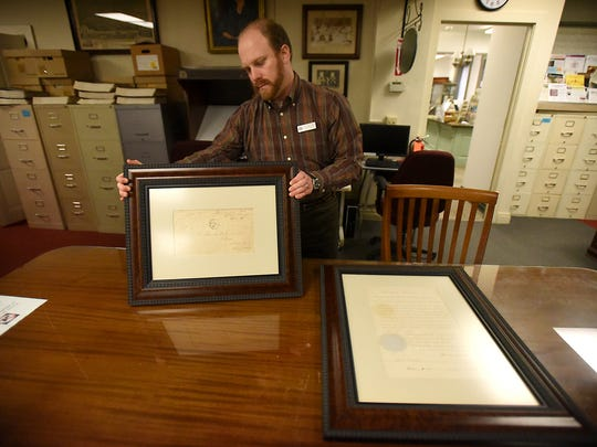 A letter from Abraham Lincoln to Lebanon industrialist George Dawson Coleman has found its way home to the Lebanon Historical Society after being in the hands of a private collector since 1961. Lebanon County Historical Society archivist and librarian Adam Bentz holds the framed letter.