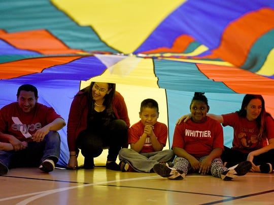 Whittier Elementary students hid under a parachute while  participating in Ed Walsh Memorial Field Day in the Rothman Center at Fairleigh Dickinson University.