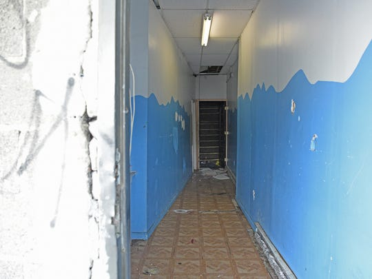 An hallway leading to a club in the back of 86 Main St. in Paterson where an early morning shooting killed one and wounded six last weekend.