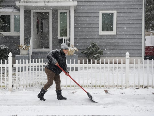 Rosalea Betanedem gets an early start clearing snow