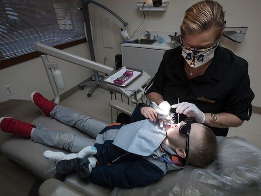 636542440686917465-ldn-mkd-021418-dentist-10.jpg