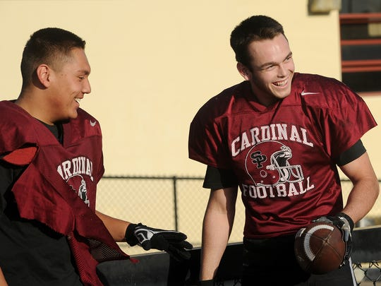 Left tackle Gabriel Segura, left, and his cousin, Anthony
