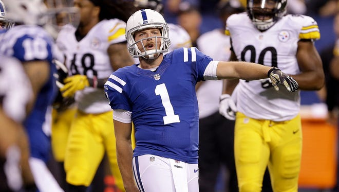 FILE -- Indianapolis Colts punter Pat McAfee (1) celebrates his pass to tight end Erik Swoope (86) in the first half of their game Thursday, November 24, evening at Lucas Oil Stadium.