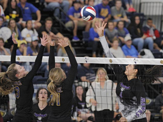 Mission Oak's Samantha Arellano looks to slip one over Bakersfield Christian defenders during a Central Section Division III championship volleyball game held in Lemoore, Calif., Saturday, Nov. 12, 2016 in the Golden Eagle Arena at West Hills College.