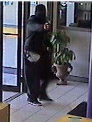 This image from security video shows a suspect in a bank robbery in Valley Junction, West Des Moines, on June 7.