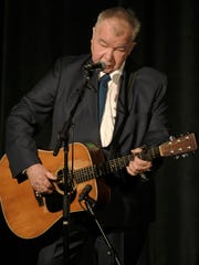 John Prine performs at the memorial service for Max Barry, son of Mayor Megan Barry, at the Belcourt Theatre in Nashville, Tenn. Tuesday, Aug. 1, 2017.