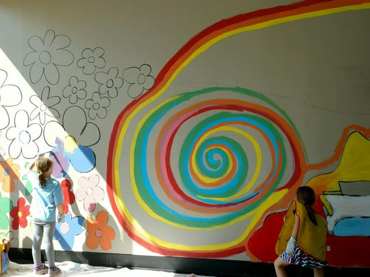 Victoria Jones Age 5, Mariana Gould 8, Victoria Bernal 8, summer campers at Childtime Center in Royal Oak, had fun painting a large mural on the wall of a vacant building that will be used during Beaumont's Cruise & View Fundraising event for Children's Miracle Network on Saturday, August 20.