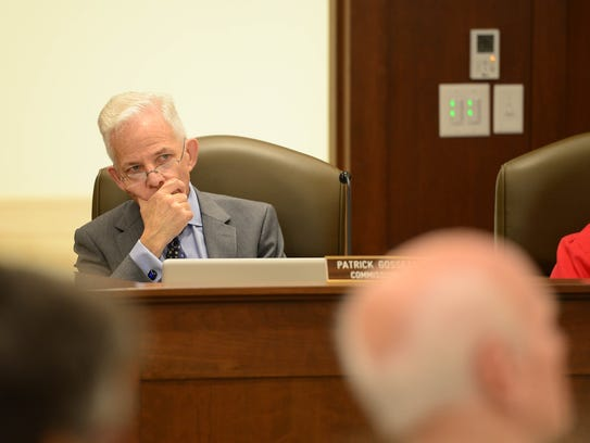Patrick Gossett, commissioner, listens as people speak during a Commissioners meeting on Monday, Nov. 6, 2017.
