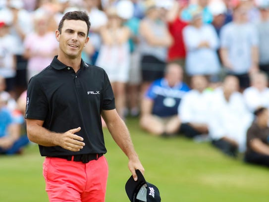 Billy Horschel goes to shake the hand of Jason Day