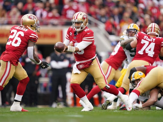San Francisco 49ers quarterback Jimmy Garoppolo (10) hands off to running back Tevin Coleman (26) in this file photo.