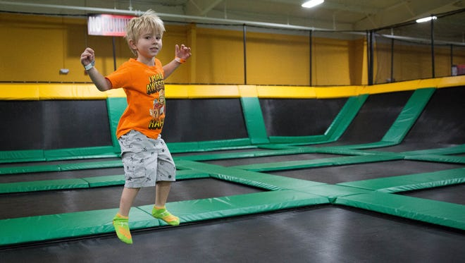 Aidan Hernandez , 5, jumps around in one of the trampoline areas at Rockin' Jump in Las Cruces.