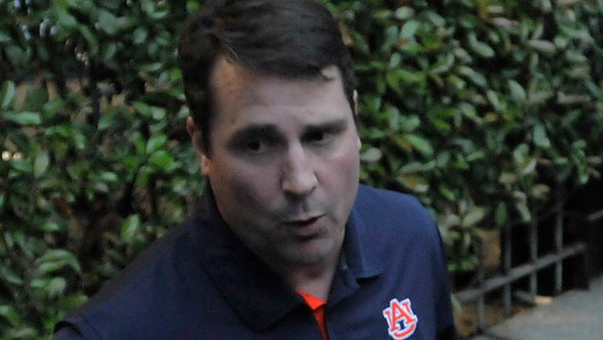 """Auburn football defensive coordinator Coach """"Boom"""" Will Muschamp talks to reporters at the Montgomery Auburn Club's Boom and BBQ at the Train Shed in downtown Montgomery on Tuesday, April 28, 2015."""