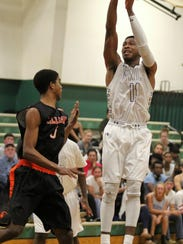 Jacquaan Lockhart shoots over a defender in a home