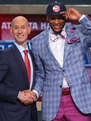 NBA Commissioner Adam Silver greets Hawks first-round pick Adreian Payne at the 2014 NBA draft.