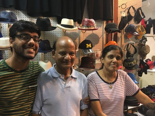 Nick Kalothia, center, is pictured with his son, Nick, and wife, Toonam at their Nick & Nicky T-shirts and Hats booth at July 28, 2017 at the Gibraltar Trade Center in Mt. Clemens.
