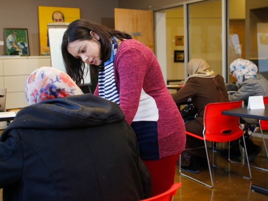 Kunti Adhikari, a native of Nepal and Michigan State University TESOL (Teacher of English to Speakers of Other Languages) graduate student works with Syrian refugees Feb. 10, 2017, at the Refugee Development Center in Lansing.