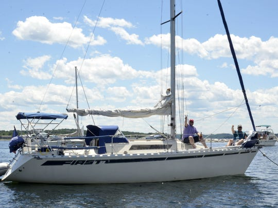 Occupants of a boat moored in Burlington's harbor say
