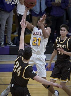 Mesa's Xavier Fuller (#21) takes a shot during a game against Crespi, December 19, 2017, at Mesa High School, 1630 E. Southern Ave., Mesa.