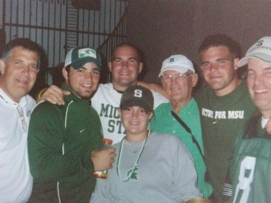 Marcus Calverley, second from left, and his family at Notre Dame Stadium following MSU's 44-41 overtime win against the Irish on Sept. 18, 2005. Calverley was a walkon and the backup long snapper for the Spartans on that team.