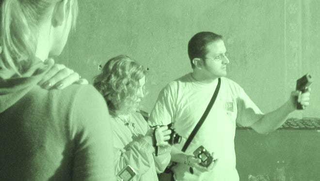 In March 2009, Neal Parks, right, led a local paranormal group through the Majestic Theatre. On Oct. 20, up to 30 people can spend the night in the Majestic seeking ghosts.