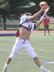 Senior Jake Giacobbi hauls in the ball during a defensive-backs