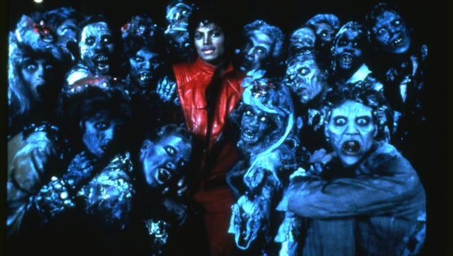 """Gadsden native Cheryl Sington is seen at Michael Jackson's left shoulder, along with other dancers who took part in the singer's iconic """"Michael Jackson's Thriller"""" music video. (USA TODAY)"""