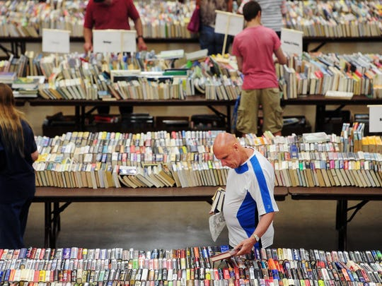 People browse through books during the the Friends of Abilene Public Library annual book sale in 2014. This year's sale is the 30th for the support organization.