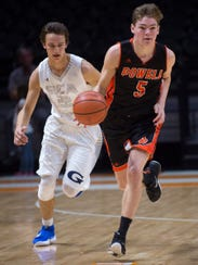 Powell's Jack Richards (5) drives down the court during