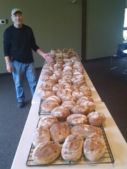 A good day of baking at the community outdoor oven yields dozens of loaves at White Bear Lake United Methodist Church, Minnesota. Bob Knutson is co-chairman of the church's outdoor bread oven ministry that is the inspiration for many churches to establish their own community ovens.