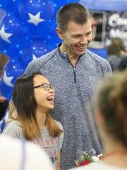 Morgan Hurd laughs with coach Slava Glazounov as she