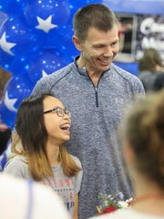 Morgan Hurd laughs with coach Slava Glazounov as she is welcomed back Wednesday at First State Gymnastics in Newark after winning the world championships in gymnastics late last week.