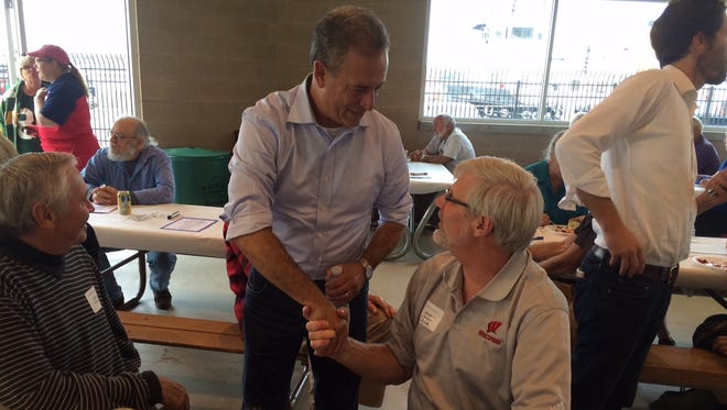 Russ Feingold shakes hands with Dana Lindh of New Glarus.