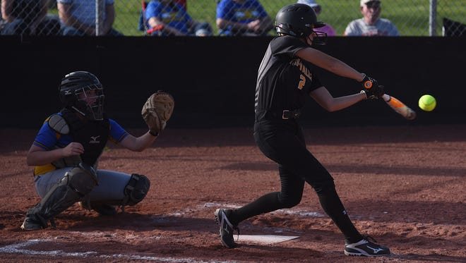 Tri-Valley's Alex Lemley puts a ball in play against Maysville.