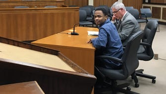 David Harris (left) sits with his attorney, Fred Klimetz, on Wednesday after the jury returned a verdict convicting Harris on six counts of racketeering, drug dealing and driving a stolen a car.