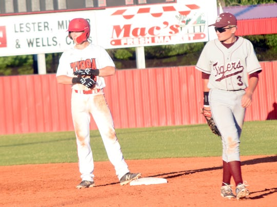 Tioga's Brady McGehee (8, left) lands on second after bringing in two runs against Breaux Bridge Friday in a home playoff game. To the right is Grayson Simon (3).