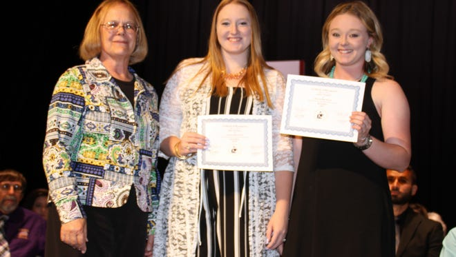 Luna County BorderBelles President Trish McSherry, left, handed scholarships to Darbi Harrington, center and Ashton Treadwell to pursue further education in helping to promote agriculture and the New Mexico beef industry.
