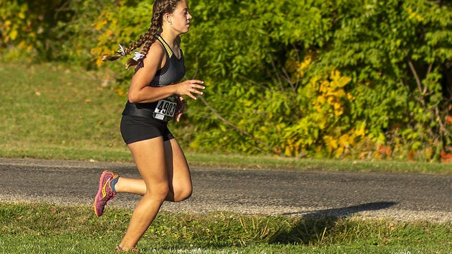 Galesburg High School sophomore Briana Admire competes in the Silver Streaks' home cross country meet with Rock Island on Thursday at Lake Storey. Admire finished first the event with a time of 20:59.7.