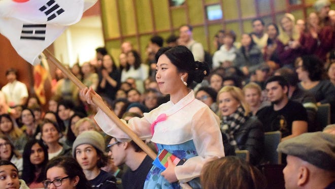 Yesol Jeong waves the South Korean flag during the Knox College 2018 I-Fair at Kresge Hall in Galesburg. Immigration and Customs Enforcement guidelines announced recently would require international college students to return home if their campus is offering remote-only learning.