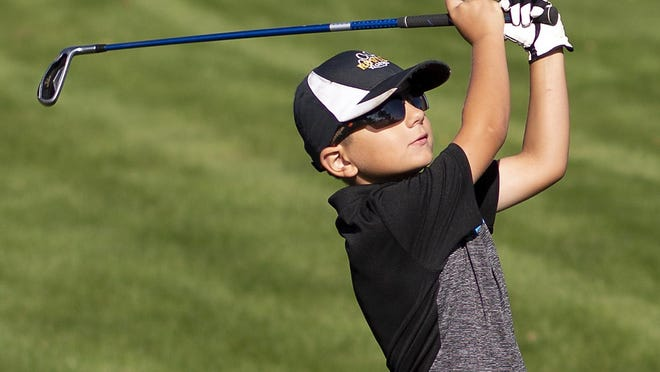 Aiden Frey watches a shot during the first round of the Galesburg Junior All-City golf tourney Tuesday, Aug. 4 at Bunker Links.
