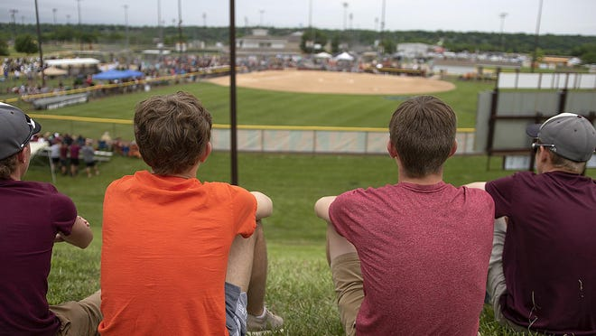 Fans watch the 2018 IHSA softball state finals at EastSide Centre in East Peoria. The finals are moving across the river to Louisville Slugger Complex in Peoria.