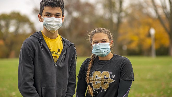 Galesburg High School cross country runners Ben Vasquez, left, and Bri Admire will be competing in IHSA sectional meet action Saturday at Peoria's Detweiller Park.