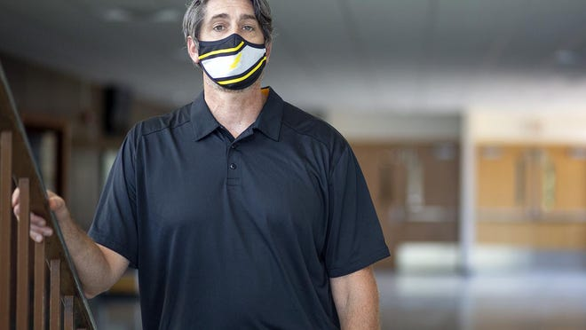 Galesburg High School Athletic Director Eric Matthews poses for a photo in the GHS front foyer on Wednesday.