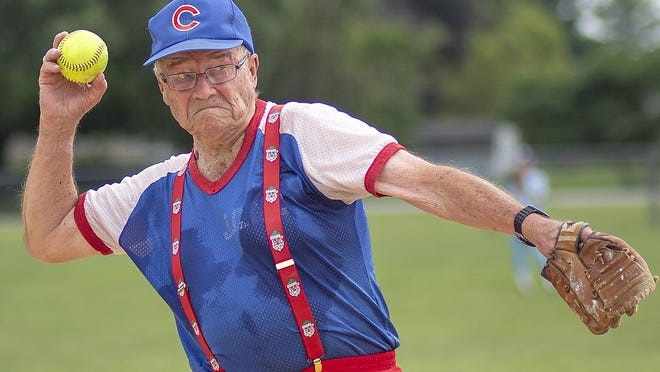 Ralph Whiteman, 92, of Monmouth, prepares to throw the ball to first base during the Monmouth Old Timers Game on Sunday at Monmouth Park. The annual fast pitch softball game has been a summer tradition since 1938.