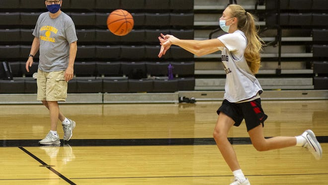 Galesburg High School's Riley Jenkins passes the ball during a drill as Streaks girls basketball coach Evan Massey looks on during a team workout on Tuesday, Sept. 15, at John Thiel Gym.