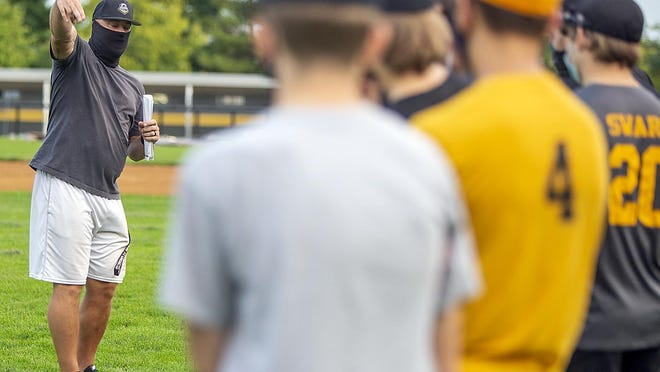 Galesburg High School baseball coach Jeremy Pickrel, left, talks to his players during practice at Jim Sundberg Field on Monday, Sept. 14, 2020.