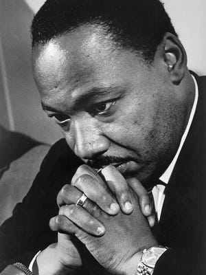 Dr. Martin Luther King Jr. is seen in this 1968 at Grosse Pointe High School.