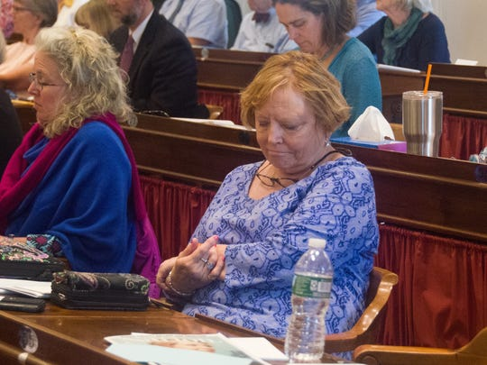 Rep. Mary Howard, D-Rutland City, listens as House Minority Leader Don Turner, R-Milton, explains his vote to uphold Gov. Phil Scott's budget veto on the floor of the House of Representatives on June 19, 2018.