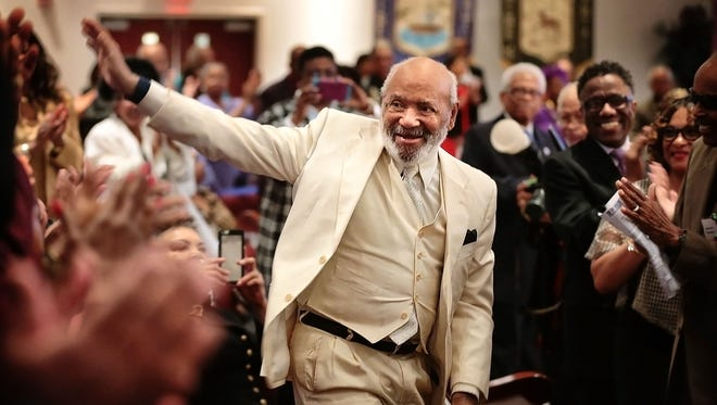 Civil rights activist James Meredith, who became the first African American to attend the University of Mississippi in 1962, responds to an ovation by members of the New Sardis Baptist Church as the church  hosts an African-American History Celebration honoring living legends.